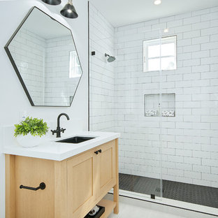 Inspiration for a beach style 3/4 white tile and subway tile white floor alcove shower remodel in Orange County with shaker cabinets, light wood cabinets, white walls, an undermount sink, a hinged shower door and white countertops
