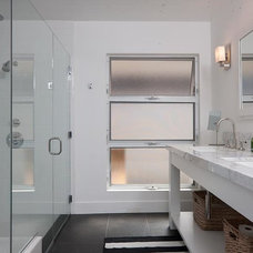 Midcentury Bathroom by Christiano Homes, Inc.