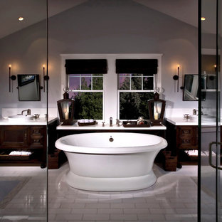 Inspiration for a timeless freestanding bathtub remodel in Orange County with furniture-like cabinets and dark wood cabinets