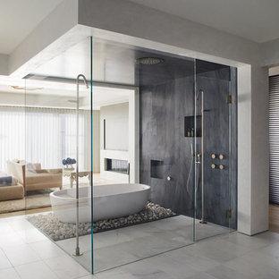 Example of a trendy gray tile beige floor bathroom design in Orange County with a hinged shower door