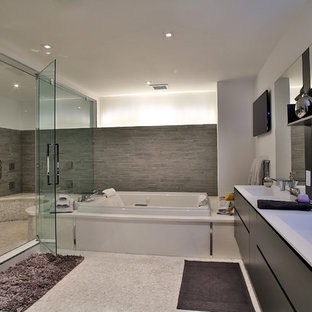 Example of a large trendy master gray tile and porcelain tile porcelain floor bathroom design in Miami with an undermount sink, flat-panel cabinets, medium tone wood cabinets and white walls