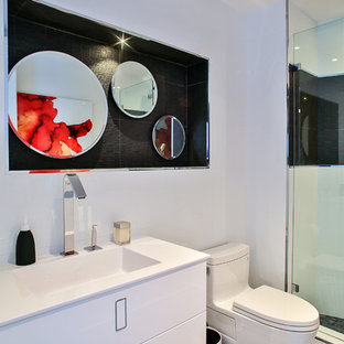Example of a large trendy 3/4 white tile and porcelain tile porcelain floor doorless shower design in Miami with an undermount sink, flat-panel cabinets, a one-piece toilet, white walls and white cabinets