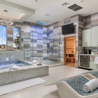 Design ideas for an expansive contemporary bathroom in Orlando with flat-panel cabinets, turquoise cabinets, a hot tub, a corner shower, a two-piece toilet, multi-coloured tile, porcelain tile, white walls, porcelain floors, with a sauna, an undermount sink, marble benchtops, white floor, a hinged shower door, white benchtops, a built-in vanity and recessed.