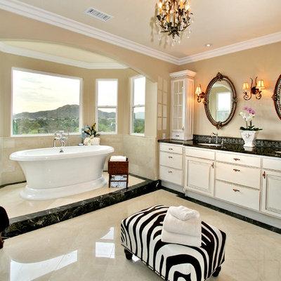 Freestanding bathtub - contemporary marble floor freestanding bathtub idea in San Diego