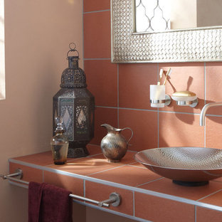 Example of a mid-sized eclectic terra-cotta tile bathroom design in Miami with a vessel sink, tile countertops and beige walls