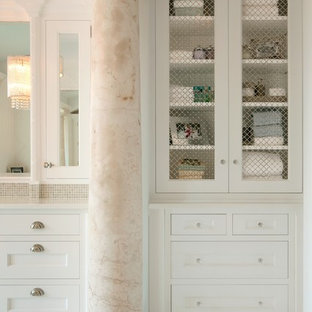 Inspiration for a large mediterranean master mosaic tile mosaic tile floor drop-in bathtub remodel in Miami with recessed-panel cabinets, white cabinets, white walls, an undermount sink and engineered quartz countertops