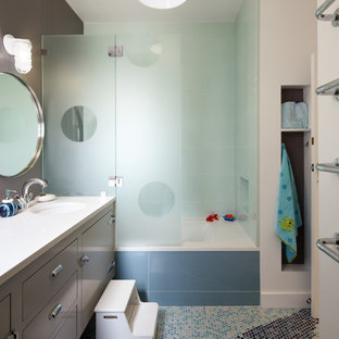 This is an example of a contemporary family bathroom in San Francisco with mosaic tiles, grey cabinets, mosaic tile flooring, brown walls and blue tiles.