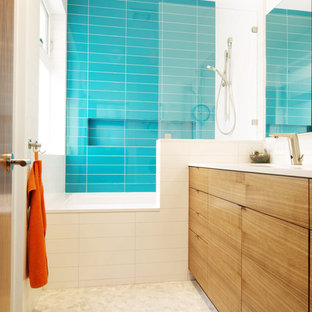 Bathroom - modern kids' blue tile pebble tile floor bathroom idea in San Francisco with flat-panel cabinets and light wood cabinets