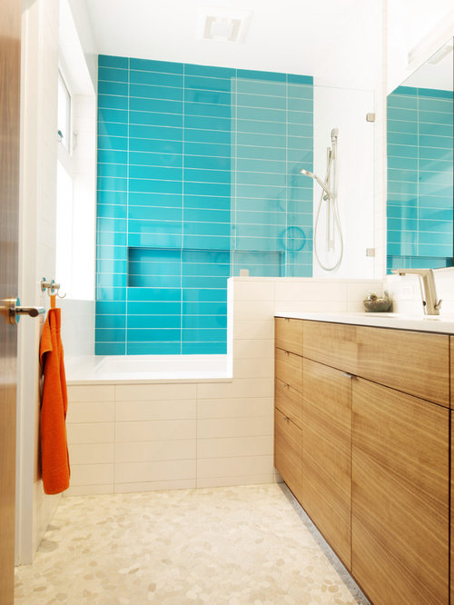 Modern kids' blue tile pebble tile floor bathroom idea in San Francisco  with flat-