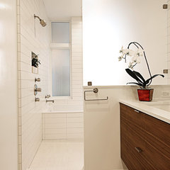 tropical bathroom by Moroso Construction