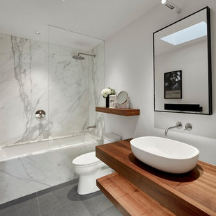 Design ideas for a contemporary bathroom in San Francisco with an undermount tub, a shower/bathtub combo, white tile, white walls, a vessel sink, wood benchtops and an open shower.