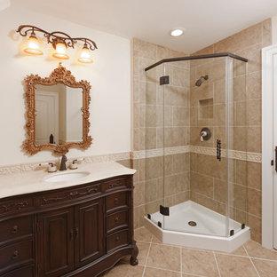 Idee per un'ampia stanza da bagno con doccia country con consolle stile comò, ante in legno bruno, doccia ad angolo, lavabo sottopiano, top in marmo, pareti beige, pavimento con piastrelle in ceramica e pavimento beige