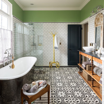 Country master white tile and subway tile cement tile floor and multicolored floor bathroom photo in Atlanta with furniture-like cabinets, medium tone wood cabinets, gray walls, a vessel sink and black countertops