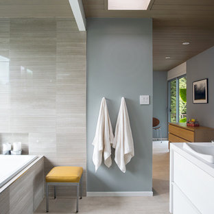 Trendy drop-in bathtub photo in San Francisco with a vessel sink and blue walls