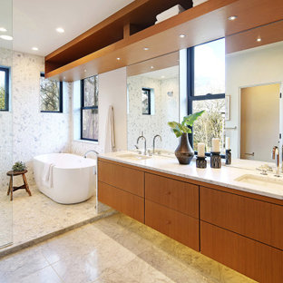 Wet room - mid-sized scandinavian master multicolored tile multicolored floor and single-sink wet room idea in Seattle with flat-panel cabinets, brown cabinets, a one-piece toilet, white walls, a drop-in sink, white countertops and a floating vanity