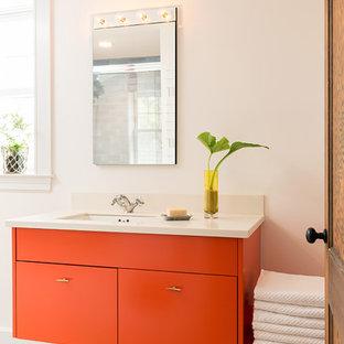 Идея дизайна: ванная комната в современном стиле с оранжевыми фасадами, белыми стенами, полом из керамической плитки, врезной раковиной и плоскими фасадами
