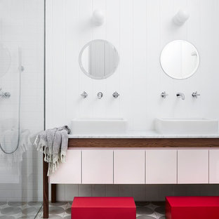 Scandinavian bathroom in Melbourne with flat-panel cabinets, a corner shower, white tile, subway tile, white walls, a vessel sink, grey floor and grey benchtops.
