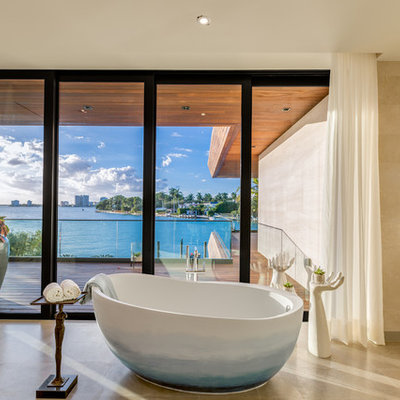 Freestanding bathtub - contemporary brown tile beige floor freestanding bathtub idea in Miami with flat-panel cabinets and beige cabinets