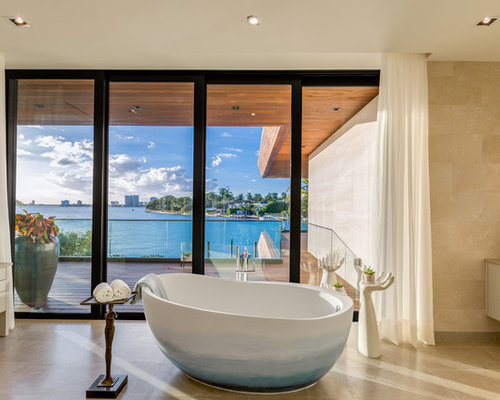 Tropical Brown Tile Beige Floor Freestanding Bathtub Idea In Miami With  Flat Panel Cabinets And