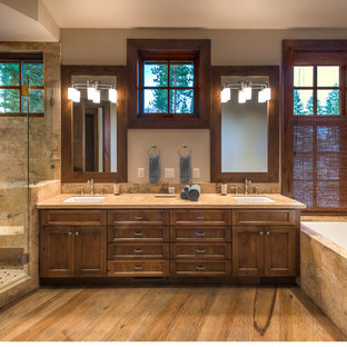 Mid-sized transitional master beige tile and stone tile light wood floor bathroom photo in Sacramento with an undermount sink, shaker cabinets, granite countertops, a one-piece toilet, beige walls and medium tone wood cabinets