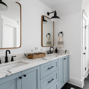Design ideas for a large rural family bathroom in Chicago with blue cabinets, white tiles, porcelain tiles, white walls, slate flooring, a submerged sink, engineered stone worktops, black floors, white worktops, double sinks, a built in vanity unit and shaker cabinets.