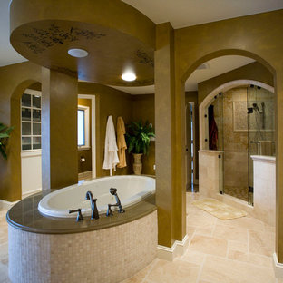 Bathroom - large traditional master beige tile and ceramic tile ceramic floor bathroom idea in Minneapolis with recessed-panel cabinets, beige cabinets, brown walls, an undermount sink and granite countertops