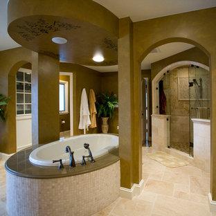 Immagine di una grande stanza da bagno padronale chic con ante con riquadro incassato, ante beige, vasca da incasso, doccia alcova, piastrelle beige, piastrelle in ceramica, pareti marroni, pavimento con piastrelle in ceramica, lavabo sottopiano e top in granito