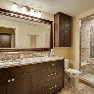Idéer för att renovera ett mellanstort vintage badrum med dusch, med luckor med infälld panel, skåp i mörkt trä, en dusch i en alkov, flerfärgad kakel, gula väggar, granitbänkskiva, ett undermonterad handfat, en toalettstol med hel cisternkåpa, keramikplattor och klinkergolv i keramik