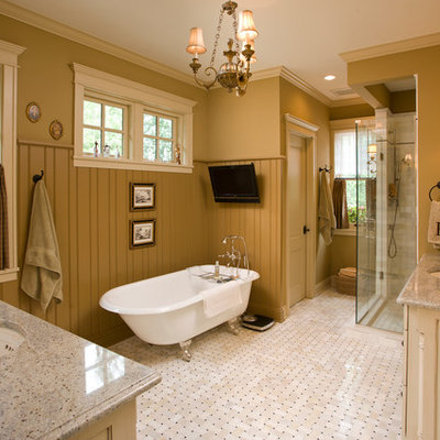 Inspiration for a mid-sized timeless master ceramic tile bathroom remodel in Minneapolis with an undermount sink, raised-panel cabinets, distressed cabinets, a one-piece toilet, green walls and granite countertops