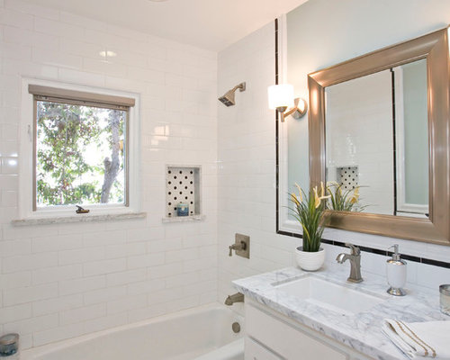 traditional white tile and subway tile bathroom idea in san diego with an undermount sink and