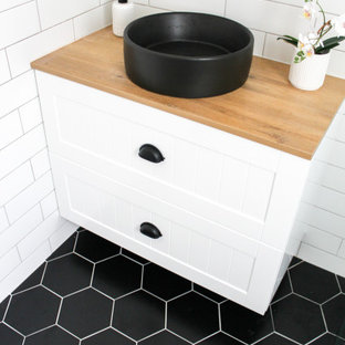 Bathroom - small modern kids' white tile and ceramic tile porcelain tile, black floor, single-sink and brick wall bathroom idea in Perth with shaker cabinets, white cabinets, a one-piece toilet, white walls, a vessel sink, wood countertops, beige countertops and a floating vanity