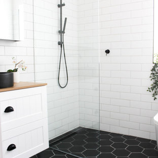Example of a small minimalist kids' white tile and ceramic tile porcelain tile, black floor, single-sink and brick wall bathroom design in Perth with shaker cabinets, white cabinets, a one-piece toilet, white walls, a vessel sink, wood countertops, beige countertops and a floating vanity