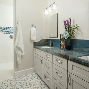 Inspiration for a mid-sized southwestern kids' white tile and ceramic tile cement tile floor and black floor bathroom remodel in Phoenix with furniture-like cabinets, black cabinets, a one-piece toilet, white walls, a vessel sink, granite countertops and blue countertops