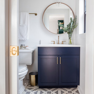 Example of a small danish master cement tile floor and multicolored floor bathroom design in Seattle with shaker cabinets, blue cabinets, a two-piece toilet, white walls, an undermount sink and quartz countertops