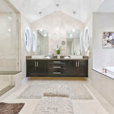 Example of a trendy beige tile bathroom design in Vancouver with a vessel sink, shaker cabinets and dark wood cabinets