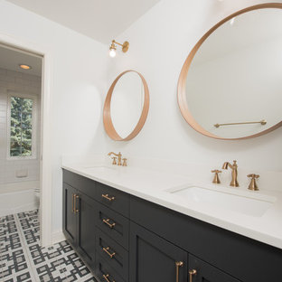 Inspiration for a large mediterranean ensuite bathroom in Chicago with shaker cabinets, black cabinets, a shower/bath combination, a one-piece toilet, white tiles, white walls, a submerged sink, multi-coloured floors and a shower curtain.