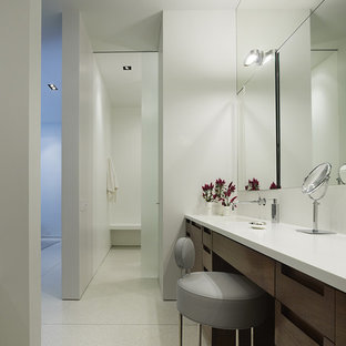 Trendy bathroom photo in Chicago with an integrated sink, flat-panel cabinets and dark wood cabinets