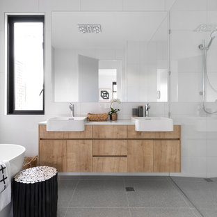 Inspiration for a contemporary master bathroom in Melbourne with flat-panel cabinets, light wood cabinets, a freestanding tub, a corner shower, white tile, mosaic tile, white walls, a vessel sink, grey floor, an open shower and beige benchtops.