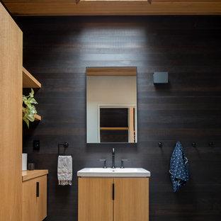 Idéer för att renovera ett funkis badrum, med släta luckor, skåp i ljust trä, betonggolv, grått golv och bruna väggar