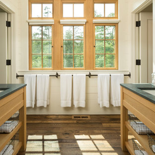 Inspiration for a rustic family bathroom in Minneapolis with a submerged sink, medium wood cabinets, soapstone worktops, white walls and dark hardwood flooring.
