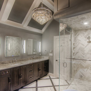Inspiration for a large modern master multicolored tile and porcelain tile porcelain tile, multicolored floor, double-sink, coffered ceiling and wood wall bathroom remodel in Other with recessed-panel cabinets, brown cabinets, a one-piece toilet, gray walls, an undermount sink, a hinged shower door, multicolored countertops, a built-in vanity and quartzite countertops