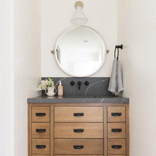 Imagen de cuarto de baño con ducha, clásico renovado, de tamaño medio, con puertas de armario de madera oscura, paredes blancas, suelo negro y encimeras multicolor