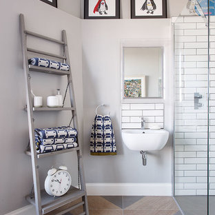 Contemporary bathroom in Other with a built-in shower, white tiles, metro tiles, grey walls, a wall-mounted sink and multi-coloured floors.