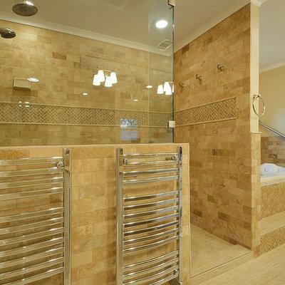 Elegant beige tile and subway tile alcove shower photo in Austin