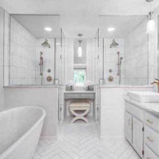 ミネアポリスの大きいトラディショナルスタイルのおしゃれなマスターバスルーム (レイズドパネル扉のキャビネット、珪岩の洗面台、ダブルシャワー、白いタイル、グレーの壁、セラミックタイルの床、ベッセル式洗面器、白いキャビネット、置き型浴槽) の写真