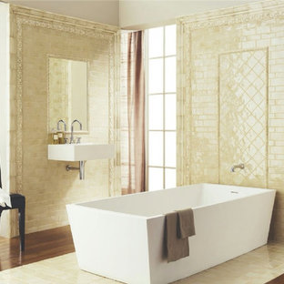 Inspiration for a large timeless master beige tile and ceramic tile medium tone wood floor freestanding bathtub remodel in Bridgeport with a wall-mount sink