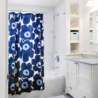 Elegant white tile bathroom photo in Chicago with an undermount sink and white cabinets