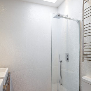 Small modern bathroom in London with a walk-in shower and an open shower.