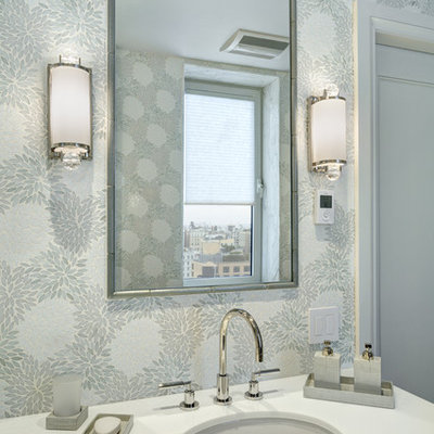 Corner shower - large transitional master gray tile, white tile and mosaic tile mosaic tile floor corner shower idea in New York with flat-panel cabinets, gray cabinets, a two-piece toilet, gray walls, an undermount sink and quartzite countertops