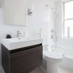 Example of a trendy white tile bathroom design in New York with a console sink, flat-panel cabinets and gray cabinets